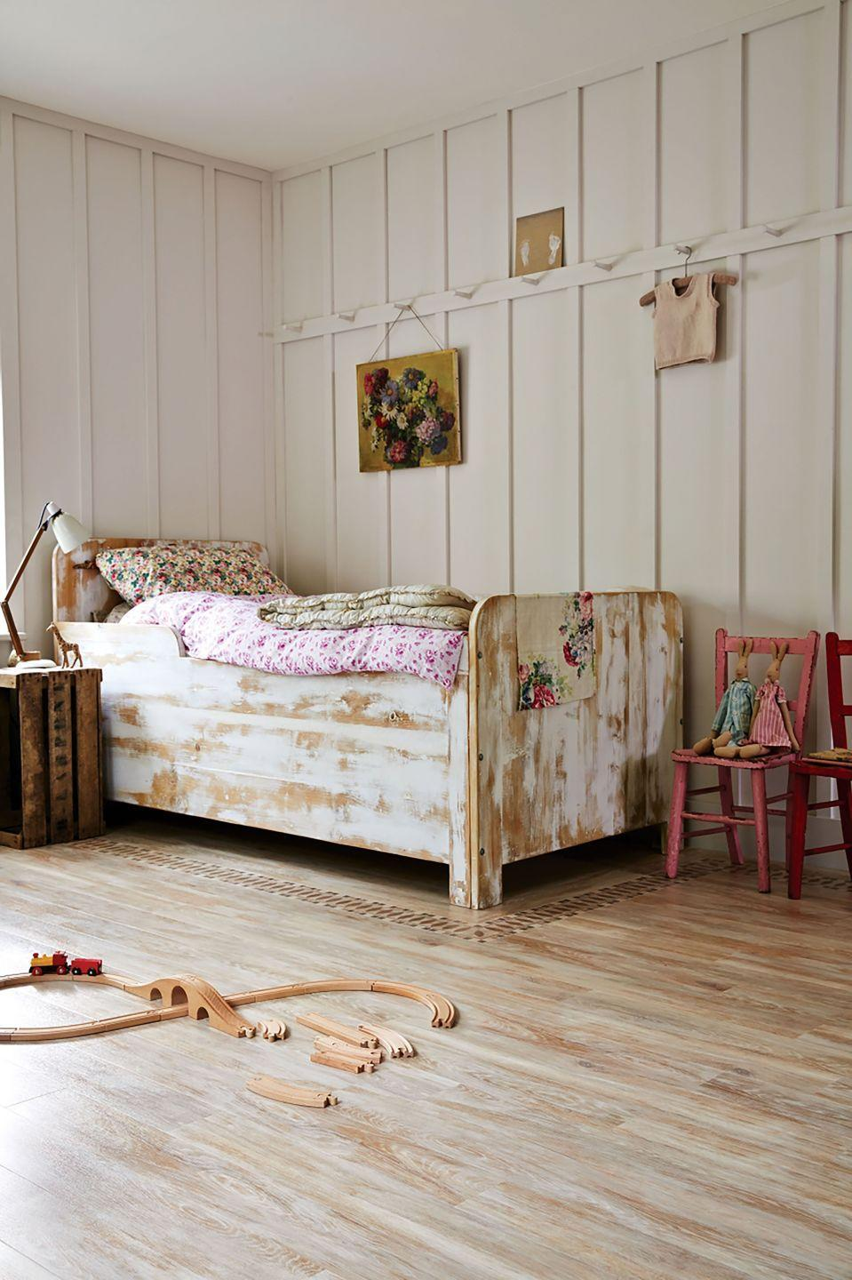 """<p>The modern rustic trend has been around for a few years now and shows no sign of abating. As seen here, it works really well for a girls' bedroom idea. It's all about creating a characterful feel – the panelling on the walls, reclaimed wood-style bed, and the upturned crate used as a bedside table. Add in vintage finds like old paintings and kids' chairs from car boot sales. A lick of paint will work wonders and will add colour to the scheme.</p><p>Pictured: Amtico lime washed wood flooring with Ellipse and Square borders and corners, <a href=""""https://www.amtico.com/flooring/products/product-search/AR0W7660/"""" rel=""""nofollow noopener"""" target=""""_blank"""" data-ylk=""""slk:Amtico"""" class=""""link rapid-noclick-resp"""">Amtico</a></p>"""