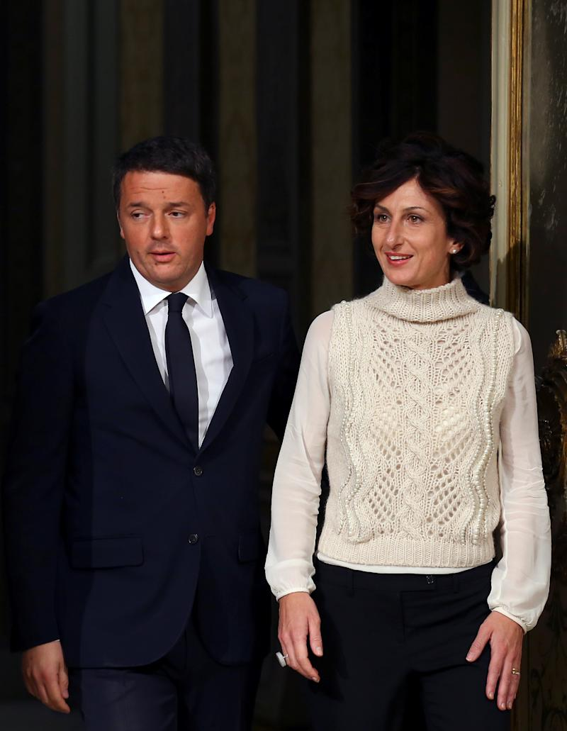 Italian Prime Minister Matteo Renzi arrives with his wife Agnese before a media conference after a referendum on constitutional reform at Chigi palace in Rome