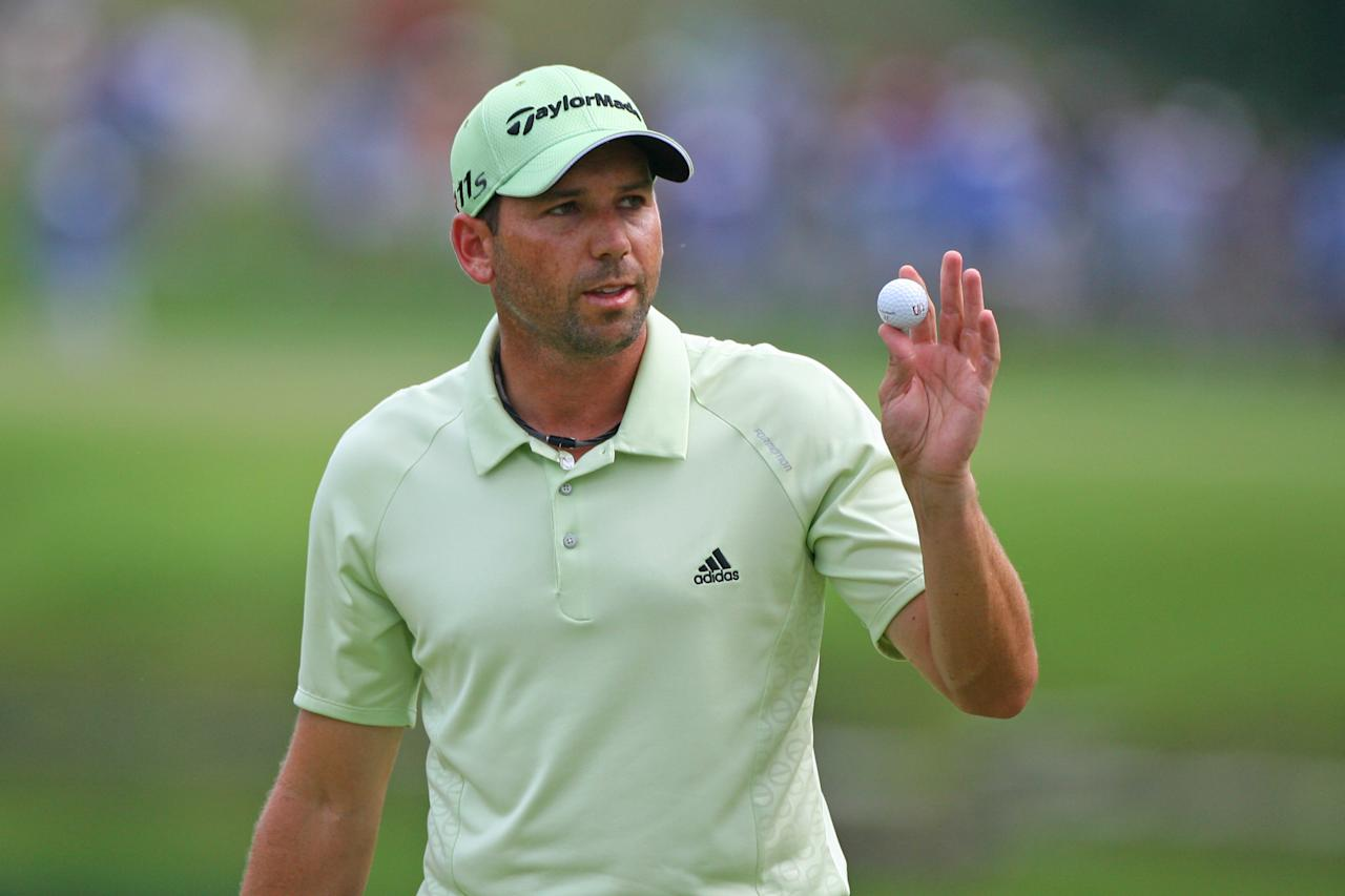 GREENSBORO, NC - AUGUST 18: Sergio Garcia of Spain waves to the crowd after making birdie on the 15th hole during the third round of the Wyndham Championship at Sedgefield Country Club on August 18, 2012 in Greensboro, North Carolina. (Photo by Hunter Martin/Getty Images)