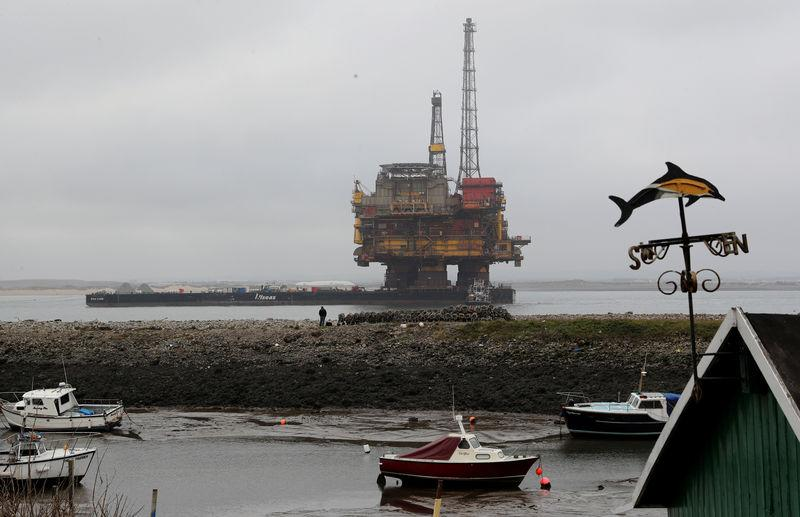 FILE PHOTO: FILE PHOTO: Shell's Brent Delta oil platform is towed into Hartlepool