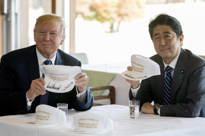 """<p>President Donald Trump and Japanese Prime Minister Shinzo Abe hold up hats they have both signed that read """"Donald and Shinzo, Make Alliance Even Greater"""" at Kasumigaseki Country Club, Sunday, Nov. 5, 2017, in Kawagoe, Japan. (Photo: Andrew Harnik/AP) </p>"""