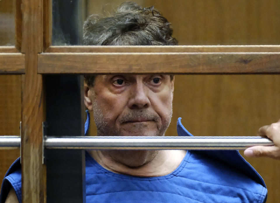 FILE - In this July 1, 2019, file photo, Dr. George Tyndall listens during his arraignment at Los Angeles Superior court in Los Angeles. The University of Southern California has agreed to an $852 million settlement with more than 700 women who have accused Tyndall, the college's longtime campus gynecologist, of sexual abuse, officials announced Thursday, March 25, 2021. (AP Photo/Richard Vogel, File)