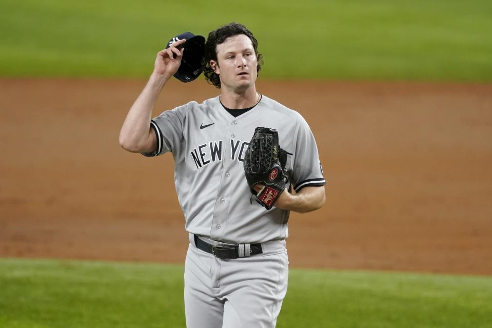 New York Yankees starting pitcher Gerrit Cole adjust his cap as he works against the Texas Rangers in the third inning of a baseball game in Arlington, Texas, Monday, May 17, 2021. (AP Photo/Tony Gutierrez)