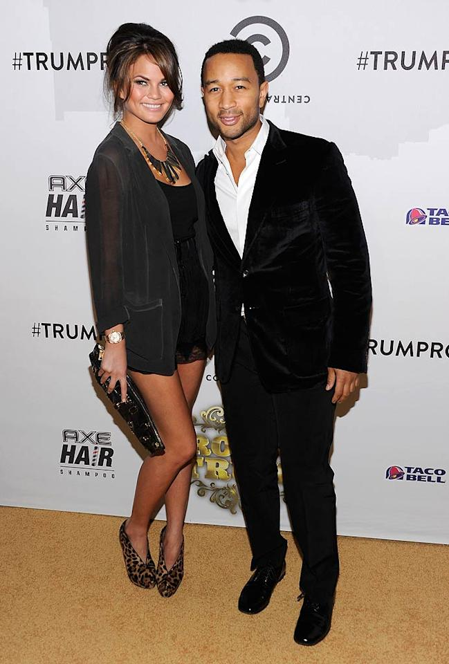 "A dapper John Legend proudly showed off his gorgeous model gal pal Christine Teigen. No word on whether or not the couple was hit with any joke shrapnel during the evening. Dimitrios Kambouris/<a href=""http://www.wireimage.com"" target=""new"">WireImage.com</a> - March 9, 2011"