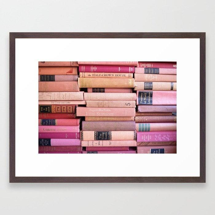 """<p>I knew I needed some art for the walls and was instantly drawn to this <a href=""""https://www.popsugar.com/buy/Society6-Vintage-Pink-Stacks-Framed-Art-Print-sorrythankyou79-575412?p_name=Society6%20Vintage%20Pink%20Stacks%20Framed%20Art%20Print%20by%20sorrythankyou79&retailer=society6.com&pid=575412&price=51&evar1=casa%3Aus&evar9=47486578&evar98=https%3A%2F%2Fwww.popsugar.com%2Fphoto-gallery%2F47486578%2Fimage%2F47486770%2FSociety6-Vintage-Pink-Stacks-Framed-Art-Print-by-sorrythankyou79&list1=shopping%2Cfurniture%2Ceditors%20pick%2Capartments%2Chome%20decorating%2Csmall%20space%20living%2Capartment%20living%2Cdecor%20shopping%2Chome%20shopping%2Cat%20home%20with%20popsugar&prop13=api&pdata=1"""" class=""""link rapid-noclick-resp"""" rel=""""nofollow noopener"""" target=""""_blank"""" data-ylk=""""slk:Society6 Vintage Pink Stacks Framed Art Print by sorrythankyou79"""">Society6 Vintage Pink Stacks Framed Art Print by sorrythankyou79</a> ($51, originally $85). As an avid reader, it fits my personality.</p>"""