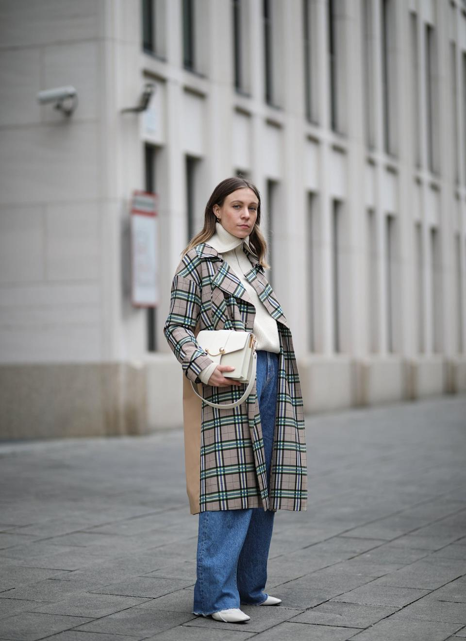 <p>Classic pieces like a sweater, a plaid coat, pointed-toe boots, and a structured bag make a pair of slouchy jeans look so polished.</p>