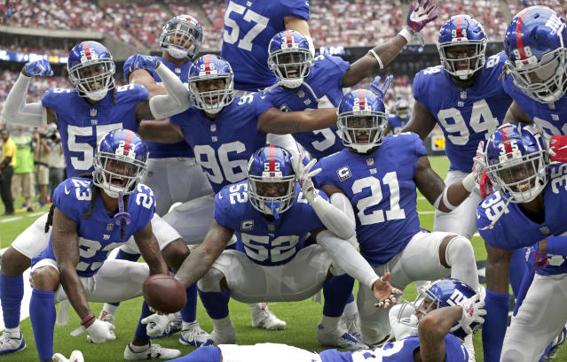 New York Giants linebacker Alec Ogletree (52) is surrounded by teammates after intercepting a pass in the end zone against the Houston Texans during the second half of an NFL football game Sunday, Sept. 23, 2018, in Houston. (AP Photo/Michael Wyke)