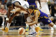 Connecticut Sun's Kalana Greene, left, and Los Angeles Sparks' Lindsey Harding, right, chase a loose ball during the second half of a WNBA basketball game in Uncasville, Conn., Tuesday, Aug. 6, 2013. The Sparks won 74-72. (AP Photo/Jessica Hill)