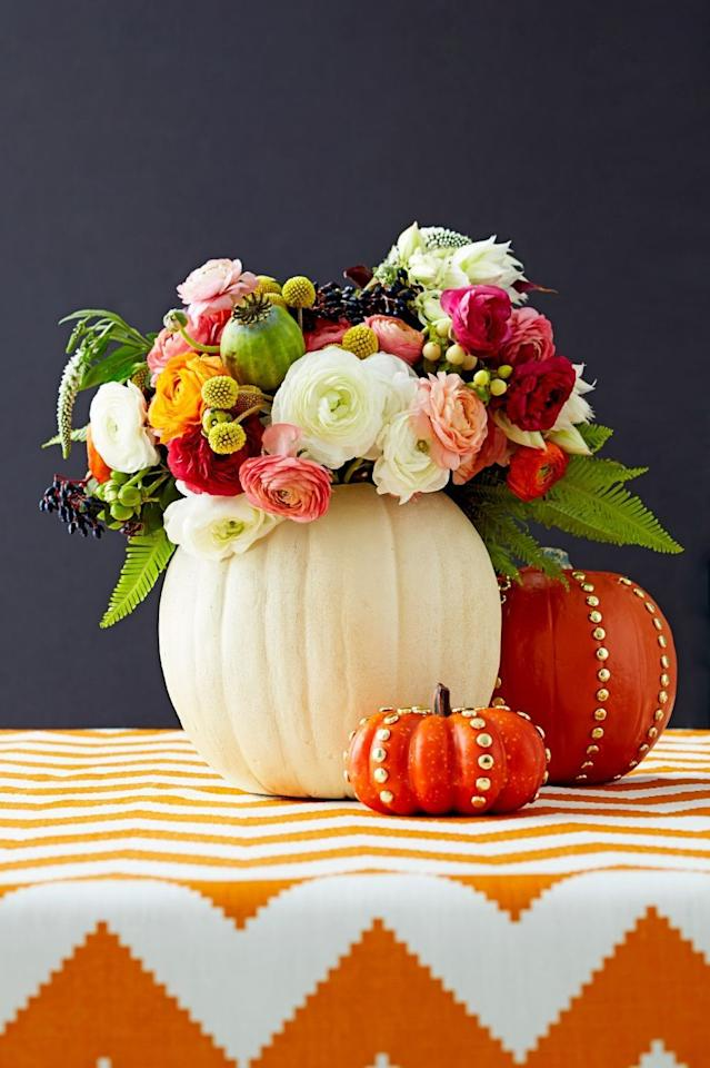 """<p>No jack-o'-lanterns here: Take advantage of the season's bounty by hollowing out <a href=""""https://www.goodhousekeeping.com/holidays/halloween-ideas/g1714/no-carve-pumpkin-decorating/"""" target=""""_blank"""">painted pumpkins</a> and filling them with autumnal blooms. </p>"""