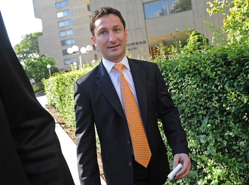 Former Goldman Sachs Group Inc. executive Fabrice Tourre enters Manhattan federal court on the first day of his trial, Monday, July 15, 2013, in New York. Tourre is accused of misleading investors about the true prospects of their bet on a package of mortgage-based securities. (AP Photo/Louis Lanzano)
