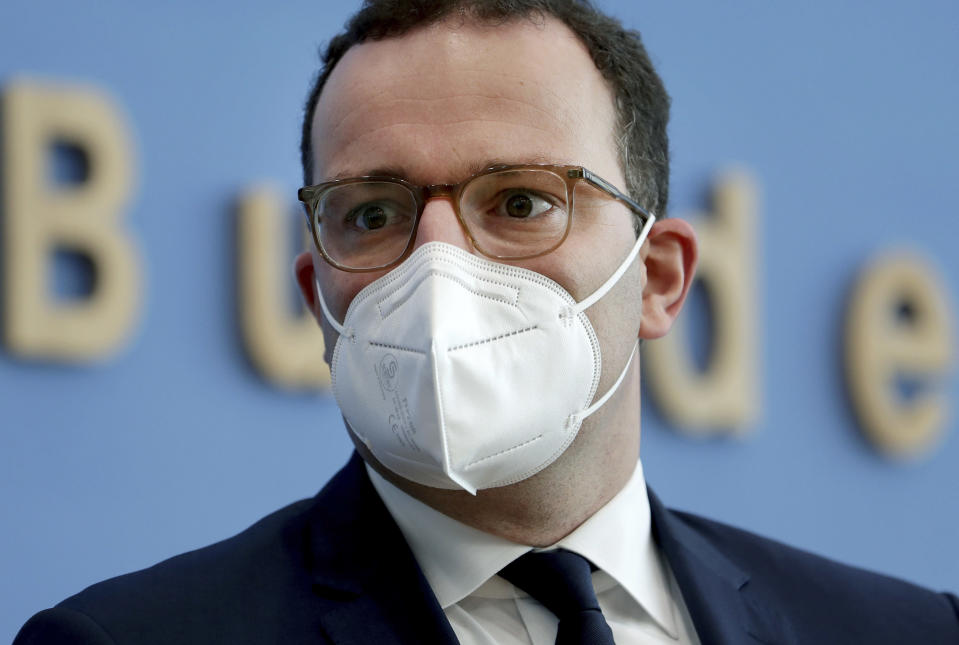 FILE - In this Tuesday, Nov. 3, 2020 file photo, German Health Minister Jens Spahn of the Christian Democratic Union, CDU, party, arrives for a press conference in Berlin, Germany. German Chancellor Angela Merkel's center-right party, the Christian Democratic Union, CDU, is choosing a new leader on the weekend Saturday Jan. 16 and Sunday Jan. 17, 2021, a decision that will help determine who succeeds Merkel at the helm of the European Union's biggest economy after a 16-year reign. (AP Photo/Michael Sohn, file, pool)