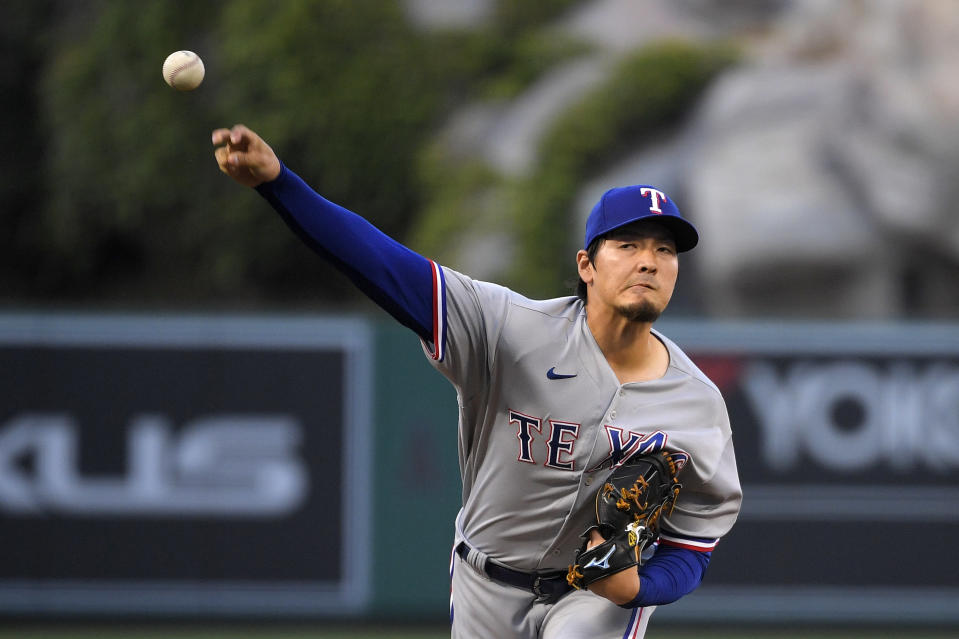 Texas Rangers starting pitcher Kohei Arihara throws to the plate during the first inning of a baseball game against the Los Angeles Angels Monday, April 19, 2021, in Anaheim, Calif. (AP Photo/Mark J. Terrill)
