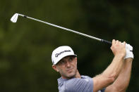 Dustin Johnson hits from the second tee during the first round of the Tour Championship golf tournament Thursday, Sept. 2, 2021, at East Lake Golf Club in Atlanta. (AP Photo/Brynn Anderson)