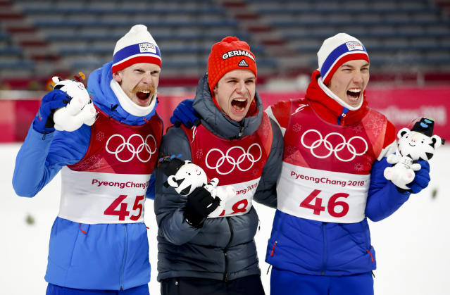 Gold medal winner Andreas Wellinger, of Germany, is flanked by silver medal winner Johann Andre Forfang, of Norway, right, and bronze medal winner Robert Johansson, of Norway, pose after the men's normal hill individual ski jumping competition at the 2018 Winter Olympics in Pyeongchang, South Korea, Sunday, Feb. 11, 2018. (AP Photo/Matthias Schrader)