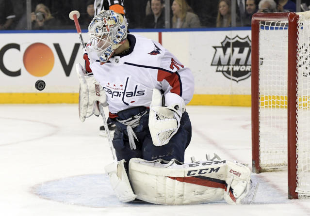 Washington Capitals goaltender Braden Holtby (70) stops the puck during the second period of an NHL hockey game against the New York Rangers, Sunday, March 3, 2019, at Madison Square Garden in New York. (AP Photo/ Bill Kostroun)
