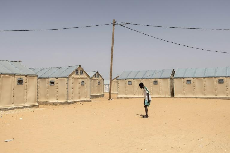 Flooding in 2017 and 2018 left more than 3,200 people homeless -- about 1,500 of them now live in a displacement camp in Djougop, further inland (AFP/JOHN WESSELS)