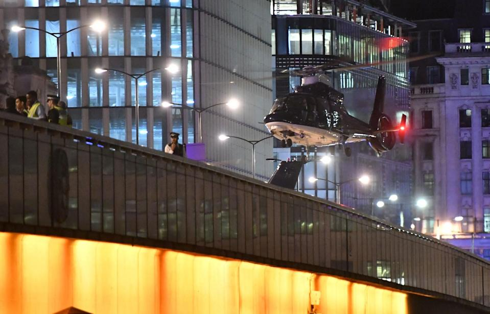 <p>A second helicopter lands on London Bridge as police respond to three incidents in the capital, amid reports that a vehicle collided with pedestrians on London Bridge. Officers are dealing with reports of stabbings in Borough Market, where armed officers attended and shots were fired. (Press Association) </p>