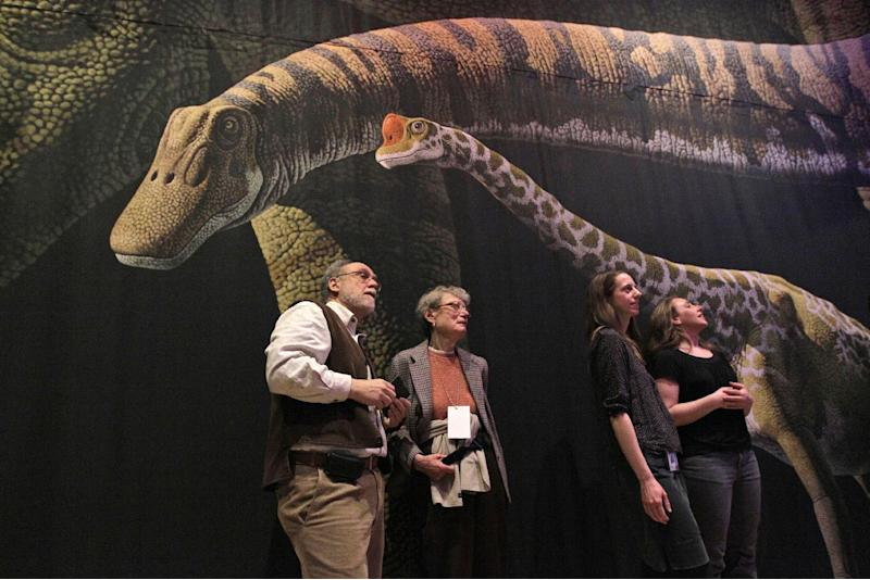 "FILE - In this April 13, 2011 file photo, visitors to the American Museum of Natural History in New York inspect a detailed model of a 60-foot-long Mamenchisaurus  on display during the media preview of ""The World's Largest Dinosaurs'"" exhibit.   The exhibition on view at the American Museum of Natural History from April 16, 2011, through January 2, 2012, explores the biology of a group of uniquely super-sized dinosaurs: the long-necked and long-tailed sauropods.  And a new study in the journal Current Biology suggests that sauropods produced enough methane, through burps and flatulence, that it helped keep an already warm Earth warmer.  (AP Photo/Mary Altaffer, File) Visitors to the American Museum of Natural history inspect a detailed model of a 60-foot-long Mamenchisaurus  on display during the media preview of ""The Worldís Largest Dinosaurs'"" exhibit, Wednesday, April 13, 2011 in New York.   The exhibition on view at the American Museum of Natural History from April 16, 2011, through January 2, 2012, explores the biology of a group of uniquely super-sized dinosaurs: the long-necked and long-tailed sauropods.  (AP Photo/Mary Altaffer)"