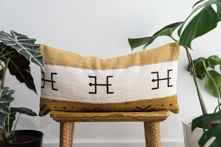"""This Spanish Etsy shop sells a selection of """"ethnic home textiles"""" and decor like pillows and blankets. Shop this <a href=""""https://fave.co/3cR4gvc"""" rel=""""nofollow noopener"""" target=""""_blank"""" data-ylk=""""slk:maroon mud Bogolan lumbar pillow for $40"""" class=""""link rapid-noclick-resp"""">maroon mud Bogolan lumbar pillow for $40</a> at <a href=""""https://fave.co/2Ae658n"""" rel=""""nofollow noopener"""" target=""""_blank"""" data-ylk=""""slk:Aishea Home on Etsy"""" class=""""link rapid-noclick-resp"""">Aishea Home on Etsy</a>."""