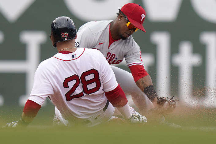 Boston Red Sox's J.D. Martinez (28) slides safely at second base on a double hit by Martinez as Philadelphia Phillies' Jean Segura (2) tries to tag him in the fifth inning of a baseball game, Sunday, July 11, 2021, in Boston. (AP Photo/Steven Senne)