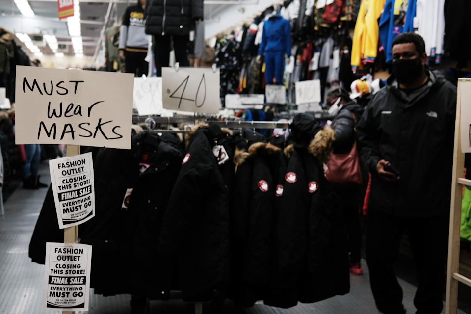 NEW YORK, NEW YORK - DECEMBER 01: A sign alerts people to wear masks at a store in Brooklyn on December 01, 2020 in New York City. New York City, and much of the nation, is bracing for a surge of COVID-19 cases following the Thanksgiving holiday which saw millions of Americans travel to see family and friends. According to the COVID Tracking Project, a record-high of 96,039 COVID-19 patients were hospitalized in the US as of Monday.  (Photo by Spencer Platt/Getty Images) (Photo: Spencer Platt via Getty Images)