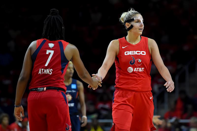 WASHINGTON, DC - SEPTEMBER 29: Elena Delle Donne #11 of the Washington Mystics celebrates with Ariel Atkins #7 after a play against the Connecticut Sun during the first half of WNBA Finals Game One at St Elizabeths East Entertainment & Sports Arena on September 29, 2019 in Washington, DC. NOTE TO USER: User expressly acknowledges and agrees that, by downloading and or using this photograph, User is consenting to the terms and conditions of the Getty Images License Agreement. (Photo by Will Newton/Getty Images)