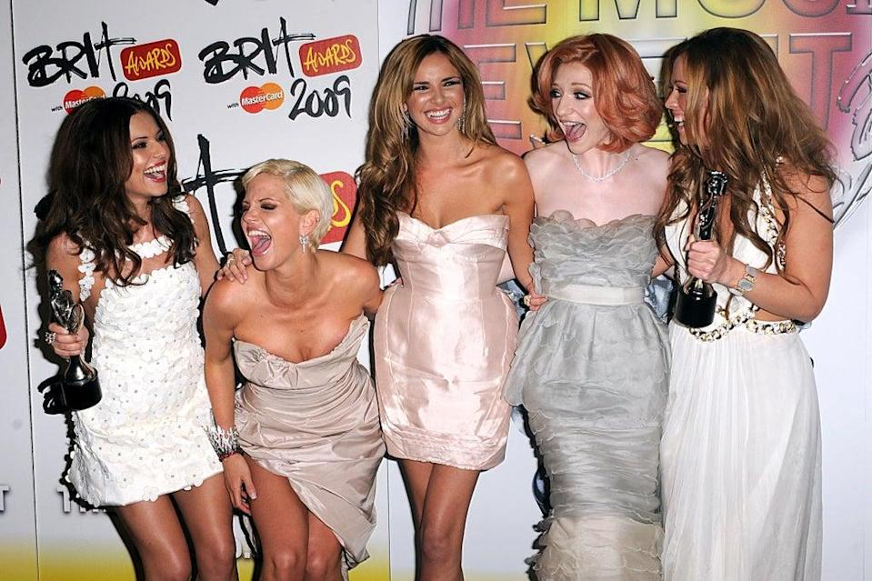 Girls Aloud with the best British single award at the Brits (PA) (PA Archive)