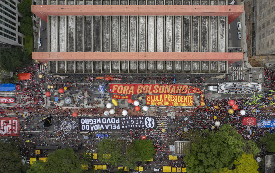 Demonstrators gather during a protest against Brazilian President Jair Bolsonaro, calling for his impeachment over his government handling of the pandemic and accusations of corruption in the purchases of COVID-19 vaccines in Sao Paulo, Brazil, Saturday, Oct. 2, 2021. (AP Photo/Andre Penner)