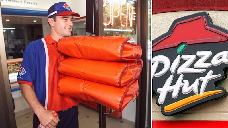 Domino's store owner going out to make a delivery on the left and Pizza Hut sign on the right.