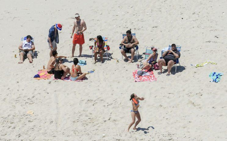 In this Sunday, July 2, 2017, photo, New Jersey Gov. Chris Christie, right, uses the beach with his family and friends at the governor's summer house at Island Beach State Park in New Jersey. (Photo: Andrew Mills/NJ Advance Media via AP)