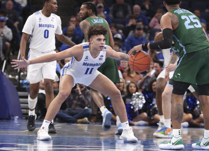 Memphis' guard Lester Quinones (11) defends Tulane guard Christion Thompson (25) in the second half of an NCAA college basketball game Monday, Dec. 30, 2019, in Memphis, Tenn. (AP Photo/Karen Pulfer Focht)