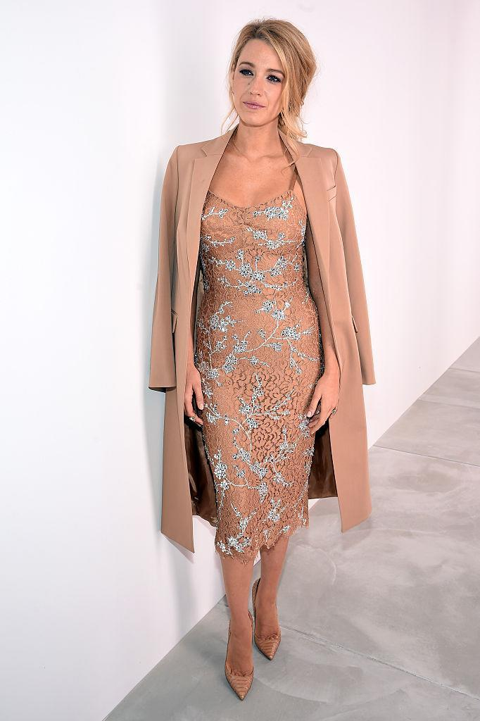 <p>Backstage at the Michael Kors AW16 show, Blake pairs a nude longline jacket with a midi dress and heels.<br><i>[Photo: Getty]</i> </p>