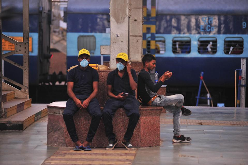 Cleaning service men wearing mask to protect themselves from corona , at Railway station in Allahabad on March 19 ,2020 .The total number of novel coronavirus cases in India rose to 166 today after a record number of fresh cases reported from the various parts of the country. Maharashtra is the worst affected state with the maximum number of cases. According to the data released by Ministry of Health and Family Welfare, the total tally includes 141 Indian nationals and 25 foreigners. (Photo by Ritesh Shukla/NurPhoto via Getty Images)