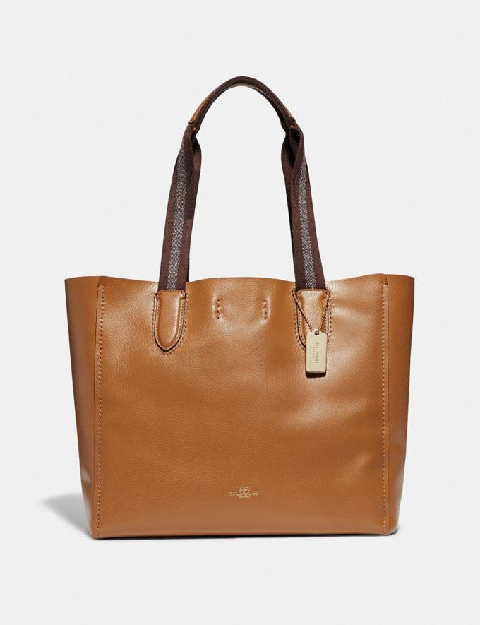 Derby Tote in light saddle. Image via Coach.