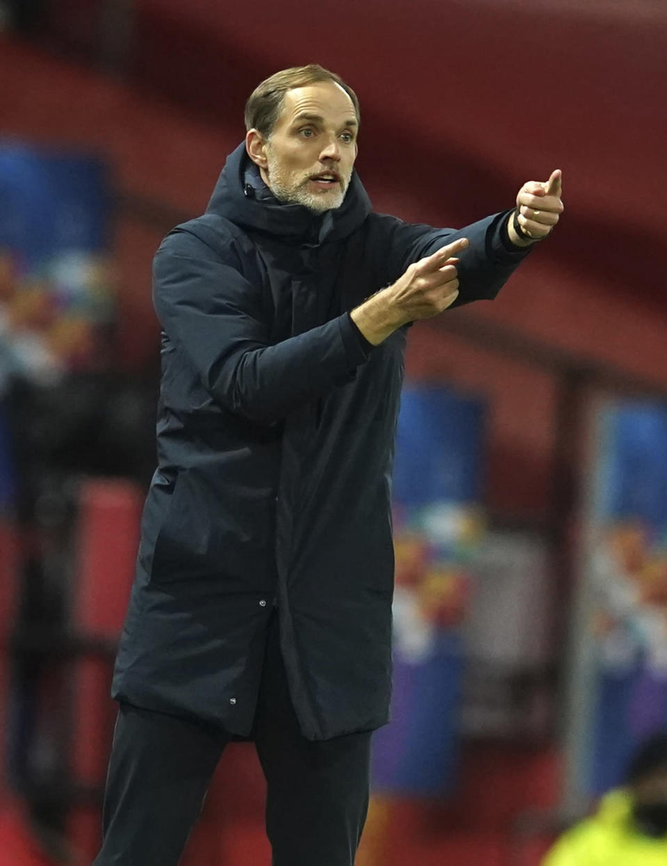 FILE - In this file photo dated Wednesday, Dec. 2, 2020, PSG's head coach Thomas Tuchel signals during a Group H Champions League soccer match against Manchester United at the Old Trafford stadium in Manchester, England. Thomas Tuchel is confirmed as the new Chelsea soccer team manager, Tuesday Jan. 26, 2021. (AP Photo/Dave Thompson, FILE)