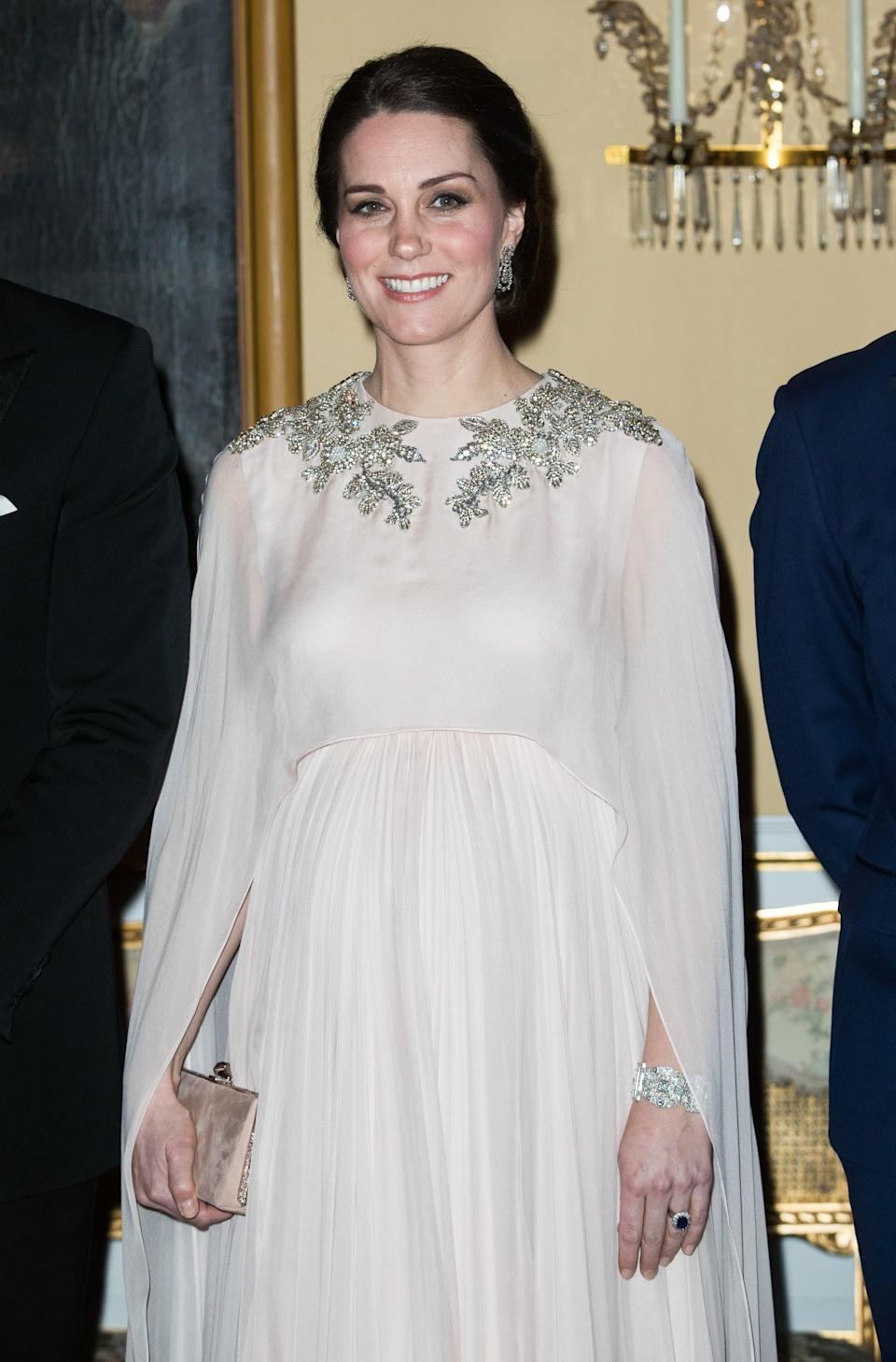 <p><strong>The occassion:</strong> A dinner held at the Royal Palace in Oslo on day three of the Duke and Duchess's Royal Tour to Sweden and Norway.<br><strong>The look:</strong> A caped blush pink Alexander McQueen gown with embellishment at the neckline. <br>[Photo: Getty] </p>