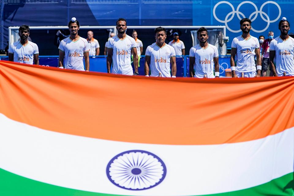 """<div class=""""paragraphs""""><p>Indian men's hockey team during the national anthem. </p></div>"""