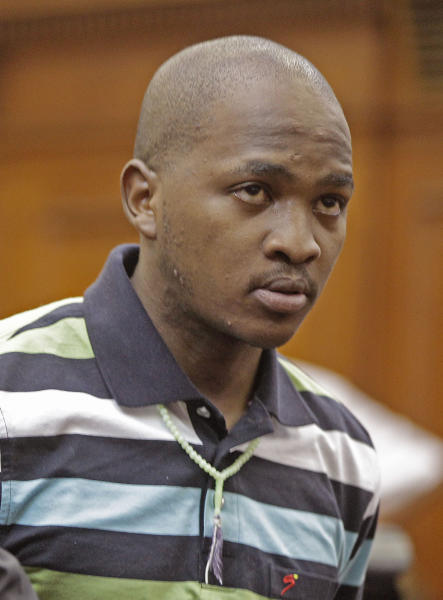 FILE - This is a Friday, Feb. 10, 2012 file photo of South African Mziwamadoda Qwabe, as, appear in the dock at court accused of taking part in the shooting death of Swedish Anni Dewani in Cape Town, South Africa. .Mziwamadoda Qwabe, one of two South African men accused of being hired by a British newlywed to kill his Swedish bride pleaded guilty Wednesday Aug. 8. 2012 to his involvement in the slaying, a prosecution spokesman said. Qwabe pleaded guilty to kidnapping, robbery, murder and illegal possession of a firearm over the November 2010 killing of Anni Dewani, whose body was found in an abandoned taxi in Cape Town's impoverished Gugulethu township, said Eric Ntabazalila, a spokesman for South Africa's National Prosecuting Authority. (AP Photo/Schalk van Zuydam, File)