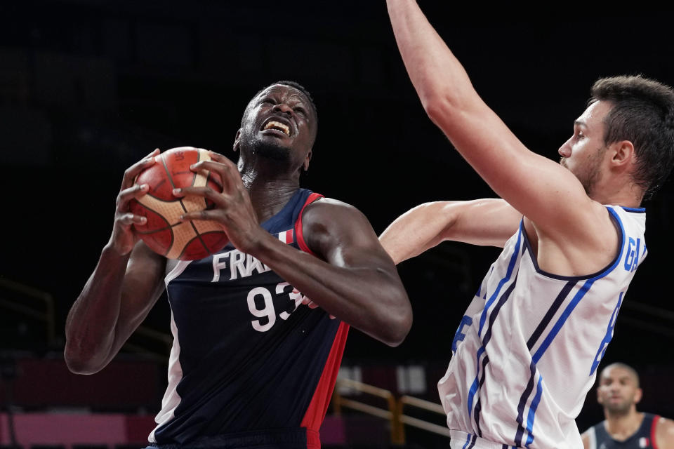 France's Moustapha Fall (93) drives to the basket against Italy's Danilo Gallinari (8) during a men's basketball quarterfinal round game at the 2020 Summer Olympics, Tuesday, Aug. 3, 2021, in Saitama, Japan. (AP Photo/Eric Gay)