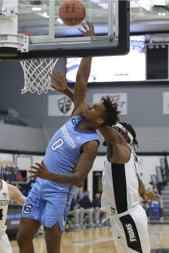 Providence's Nate Watson (0) fouls Creighton's Antwann Jones (0) during the first half of an NCAA college basketball game Saturday, Jan. 2, 2021, in Providence, R.I. (AP Photo/Stew Milne)