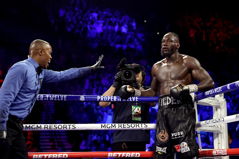 Referee Kenny Bayless sends Deontay Wilder to his corner during the heavyweight bout for Wilder's WBC and Fury's lineal heavyweight title against Tyson Fury on February 22, 2020, at MGM Grand Garden Arena in Las Vegas, Nevada.