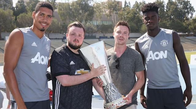 <p>Chris Smalling and Axel Tuanzebe provide bookends for Game of Thrones stars John Bradley-West (Samwell Tarly) and Joe Dempsie (Gendry), as the hold Manchester United's Europa League trophy.</p>