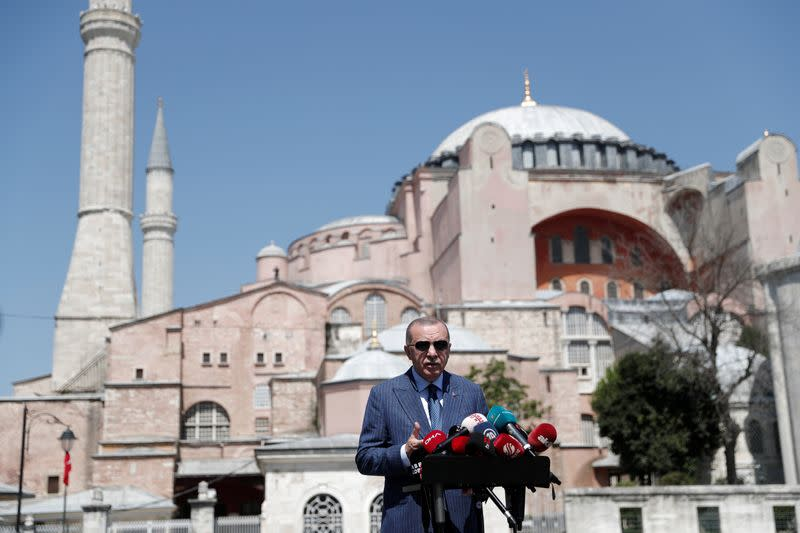 Turkish President Tayyip Erdogan talks to media after attending Friday prayers at Hagia Sophia Grand Mosque in Istanbul