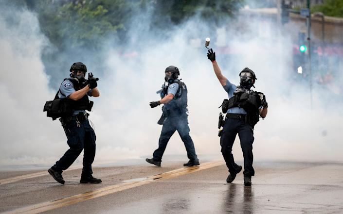 Police took on the protesters with stun grenades and tear gas - Carlos Gonzalez/AP