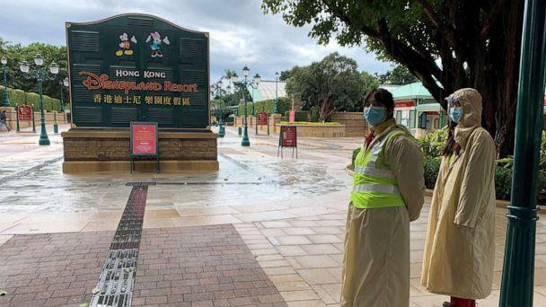 PHOTO: Employees wearing protective masks stand outside the Hong Kong Disneyland theme park that has been closed, following the coronavirus outbreak, in Hong Kong, China January 26, 2020. (James Pomfret/Reuters, FILE)