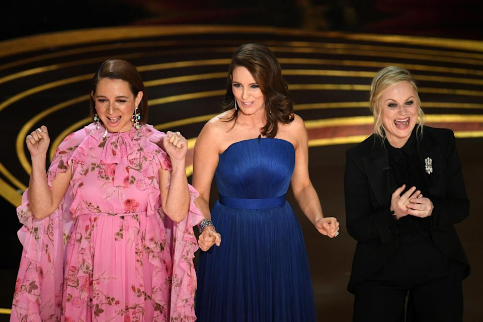 Maya Rudolph, Tina Fey and Amy Poehler speak onstage during the 91st annual Academy Awards. (Photo: Kevin Winter/Getty Images)