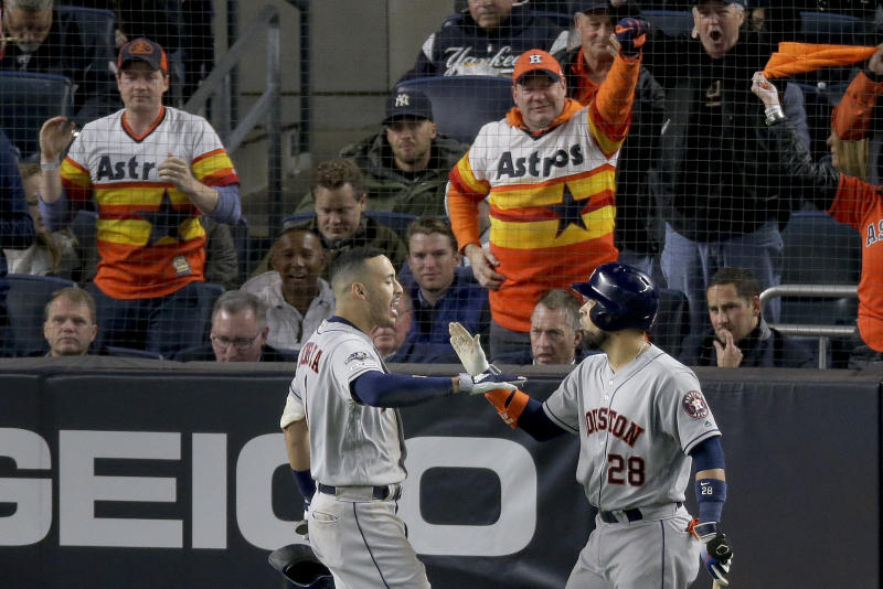 Houston Astros shortstop Carlos Correa (1) celebrates with Robinson Chirinos (28) after hitting a three-run home run against the New York Yankees during the sixth inning of Game 4 of baseball's American League Championship Series, Thursday, Oct. 17, 2019, in New York. (AP Photo/Seth Wenig)