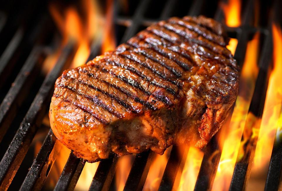 """<p>It's not hard to make grilled steak taste fantastic, but there are some things you can do to really elevate the flavor. Smith tells Woman's Day that he loves to cook a bone-in New York strip steak by placing the side with the thick piece of fat on the grill, and rubbing that fat on the hot grill. </p><p>""""The fat will melt and coat the grates really well, resulting in a smoky flavor,"""" he says. """"Always cook steak and other meats on a low to medium heat and slowly. If desired, sear it last minute quickly moving from side to side."""" </p>"""