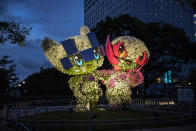 <p>TOKYO, JAPAN - JULY 29: Floral arrangements of Mascots of Tokyo 2020 Olympic Games, Miraitowa (L) and Someity (R) are illuminated at twilight during Day Six of the Tokyo Olympic Games on July 29, 2021 in Tokyo, Japan. (Photo by Maja Hitij/Getty Images)</p>