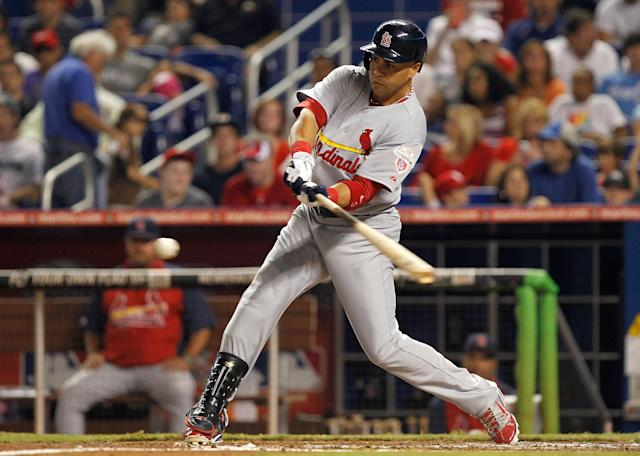 MIAMI, FL - JUNE 26: Carlos Beltran #3 of the St. Louis Cardinals hits during a game against the Miami Marlins at Marlins Park on June 26, 2012 in Miami, Florida. (Photo by Mike Ehrmann/Getty Images)